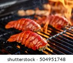 Grilling Lobster Over Hot Flame