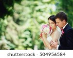 groom hugged the bride and she... | Shutterstock . vector #504956584