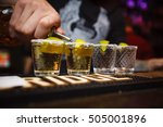 the bartender pours tequila in... | Shutterstock . vector #505001896