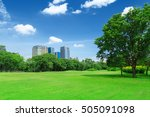 green grass field in big city... | Shutterstock . vector #505091098