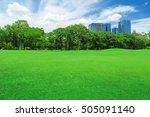 green grass field in big city... | Shutterstock . vector #505091140