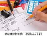 Small photo of Maths quadratic equation concepts. School supplies used in maths. Maths drawing tools with maths equation. Maths equation exercise sheet with school drawing tools. Close-up of simple maths equation.