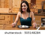 beautiful woman eating meal in...