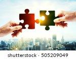 hands putting puzzle piece... | Shutterstock . vector #505209049
