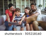 smiling family sitting on sofa... | Shutterstock . vector #505218160