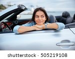 smiling young woman sitting... | Shutterstock . vector #505219108