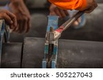 Small photo of Hand of workers holding spanner jaws of death. To screw to unlock.
