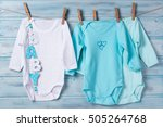 baby clothes and word baby on a ... | Shutterstock . vector #505264768