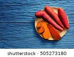 sweet potato on wooden cutting... | Shutterstock . vector #505273180