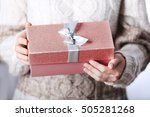 woman holding box with... | Shutterstock . vector #505281268