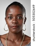 Stock photo portrait of real black african woman with no expression id or passport photo full collection of 505302649