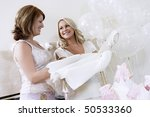 bride showing off dress at... | Shutterstock . vector #50533360