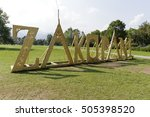 Small photo of ZAKOPANE, POLAND - SEPTEMBER 13, 2016: Huge lettering creates name of the city. Wooden letters are made using elements ornamentation of the architectural style of Zakopane