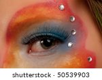 girl eye close-up with colored make-up - stock photo