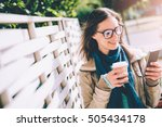 woman holding takeaway coffee