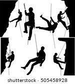 rock climbers silhouette...