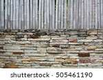 Bamboo Fence On Stone Wall