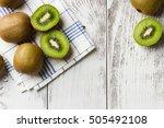 kiwi on white wooden background.... | Shutterstock . vector #505492108