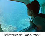 Woman Sit In Glass Bottom Boat...