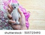 hand holding crocheted... | Shutterstock . vector #505725493