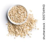 dry rolled oatmeal in bowl... | Shutterstock . vector #505734943