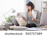 shocked woman at home checking...   Shutterstock . vector #505757389