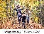 a family of four enjoying... | Shutterstock . vector #505937620
