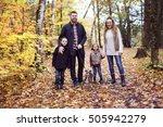 a family of four enjoying... | Shutterstock . vector #505942279