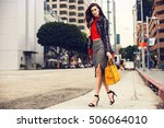 fashionable brunette woman in a ... | Shutterstock . vector #506064010