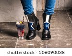 legs of standing on the grey... | Shutterstock . vector #506090038
