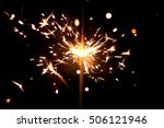 sparklers on a black background.... | Shutterstock . vector #506121946
