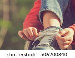 kid girl tying her shoes. | Shutterstock . vector #506200840