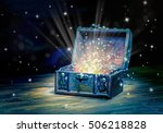 Small photo of close up concept greeting card of opened vintage chest treasure with mystical miracle light on wooden background, beautiful fine art design