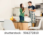 young couple on the kitchen... | Shutterstock . vector #506272810