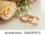 wedding rings lie on a... | Shutterstock . vector #506395573