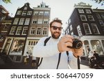 happy stylish photographer with ... | Shutterstock . vector #506447059