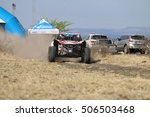 Small photo of Sun City, South Africa - OCTOBER 1, 2016: Speeding white and red Bat Spec 5 rally car at start of race at Sun City 450 Rally Racing event, Sun City, South Africa