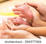 newborn baby feet in mother's... | Shutterstock . vector #506577406