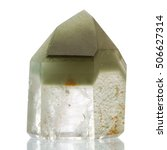 Small photo of Quartz polished point with Chlorite phantom crystal on white background