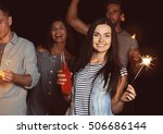 happy friends with sparklers on