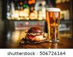 hamburger and light beer on a...   Shutterstock . vector #506726164