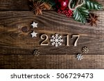 Small photo of Sigh symbol from number 2017 on vintage style wooden texture background. Happy New Year 2017 greetings on wooden. snowflake wood. Empty space for your text. instead of zero snowflake