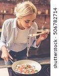 beautiful girl is tasting food...   Shutterstock . vector #506782714
