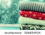 pile of sweaters. winter. | Shutterstock . vector #506854924