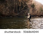 fisherman catches of grayling... | Shutterstock . vector #506864044