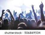 silhouettes of concert crowd in ... | Shutterstock . vector #506869534
