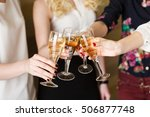 hands holding the glasses of... | Shutterstock . vector #506877748