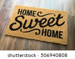 Small photo of Home Sweet Home Welcome Mat On Wood Floor.
