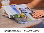 female reading a magazine and... | Shutterstock . vector #506959399