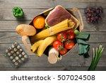 full paper bag of groceries on... | Shutterstock . vector #507024508